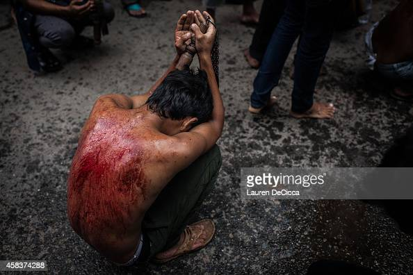 Shi'ite Muslim boy participates in Ashura a commemoration involving selfflagellation to mourn the martyrdom of Husayn ibn Ali the grandson of...