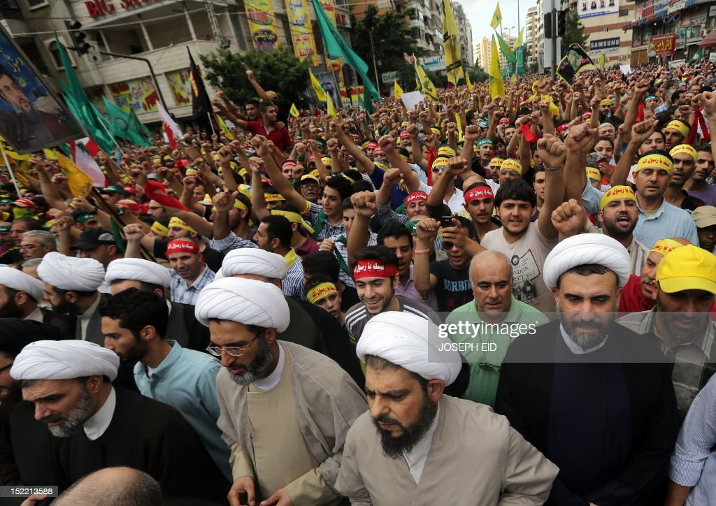 Shiite Muslim clerics and supporters of Lebanon's Hezbollah group march during a rally in southern Beirut to denounce a film mocking Islam on September 17, 2012. Hezbollah chief Hassan Nasrallah, who made a rare public appearance at the rally, has called for a week of protests across the country over the low-budget, US-made film, describing it as the 'worst attack ever on Islam.' AFP PHOTO / JOSEPH EID
