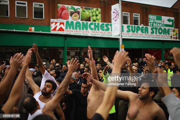 Shiite Muslim devotees beat their chests as they take part in a ritual selfflagellation procession on October 23 2015 in Manchester England Shiites...