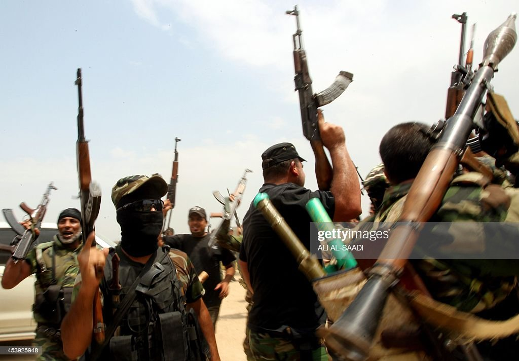 Shiite Muslim fighters from the Saraya alSalam a group formed by Iraqi Shiite Muslim cleric Moqtada alSadr and tasked with defending the holy sites...