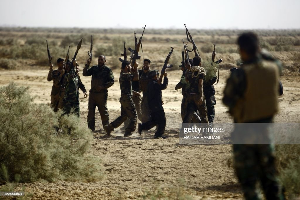 Shiite Muslim fighters loyal to Iraqi Shiite cleric Moqtada alSadr take part in a last combat training near the city of Najaf on August 23 before...