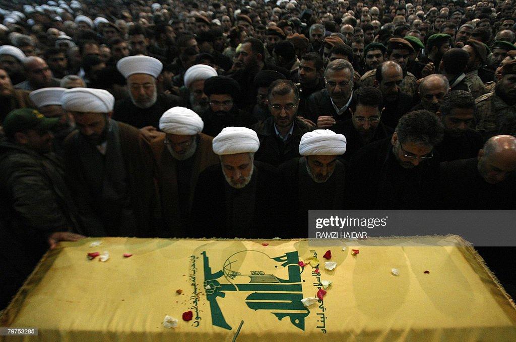 Shiite Muslim Hezbollah Deputy Secretary General Naim Qassem prays over the coffin of assassinated Hezbollah commander Imad Mughnieh in Beirut's...