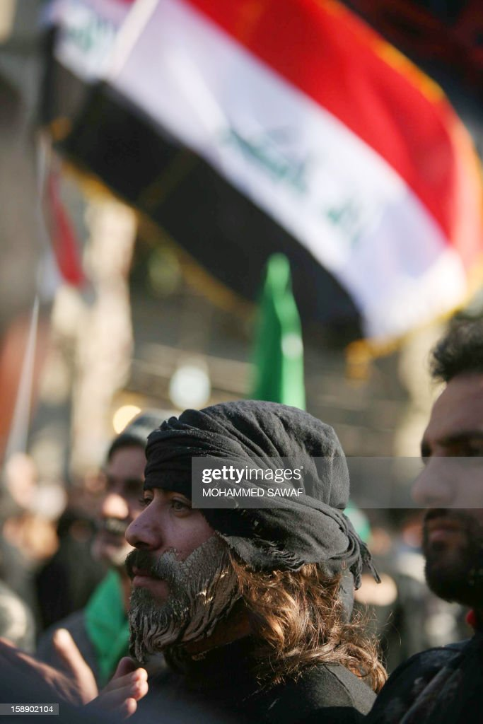 A Shiite Muslim man attends the Arbaeen religious festival in the shrine city of Karbala, southwest of Iraq's capital Baghdad, on January 3, 2013 to mark the 40th day after Ashura, commemorating the seventh century killing of Prophet Mohammed's grandson, Imam Hussein.