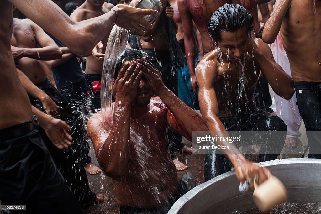 Shi'ite Muslim man cleans himself after the selfflagellation ritual during Ashura on November 4 2014 in Yangon Burma Ashura is a Shi'ite Muslim...