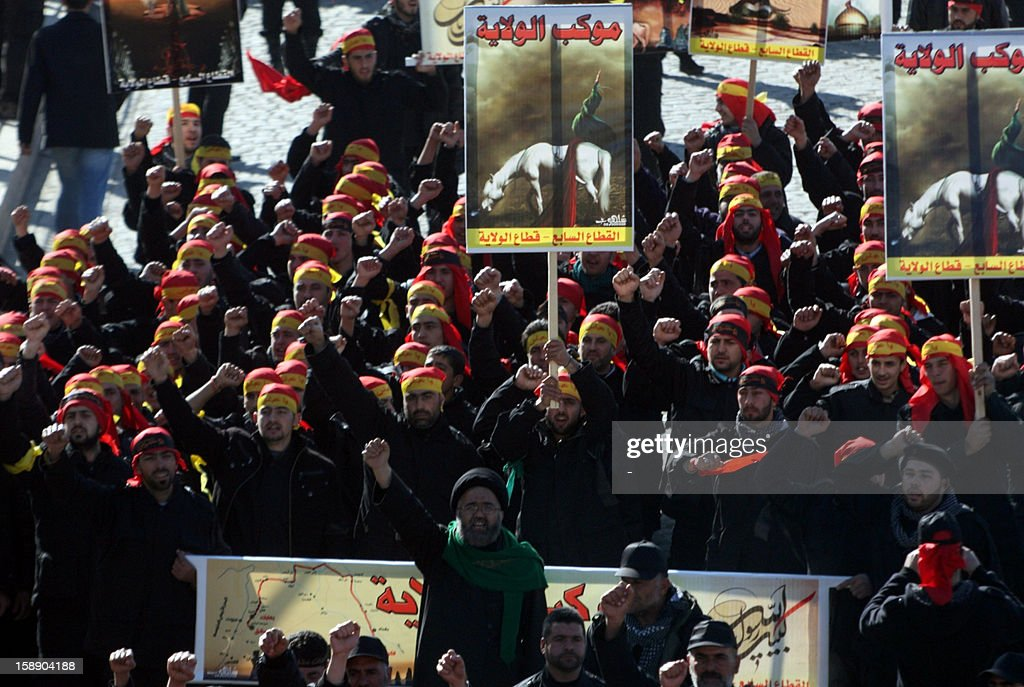 Shiite Muslim men attend the Arbaeen religious festival in the eastern Lebanese city of Baalbek, on January 3, 2013 to mark the 40th day after Ashura, commemorating the seventh century killing of Prophet Mohammed's grandson, Imam Hussein. War-torn Syria is threatened with 'schemes of division and partition', the head of Lebanon's Hezbollah movement, Hassan Nasrallah, said in a televised speech marking the Arbaeen. AFP PHOTO / STR