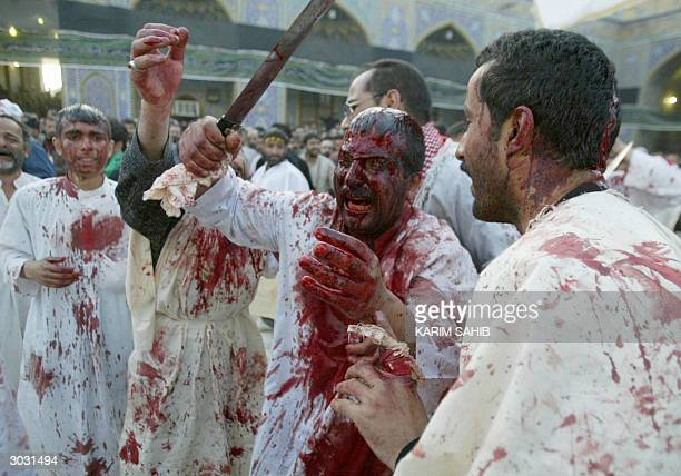 Shiite Muslim men cut themselves with swords and razors letting their wounds stream blood as they beg Imam Hussein's forgiveness during the annual...