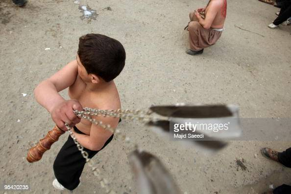 Shiite Muslim men flay themselves with chains and blades during Ashura in Kabul Afghanistan on December 27 2009 Ashura is a 10 day period of mourning...
