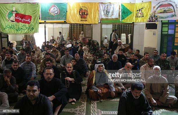 Shiite Muslim men listen to a speech by Iran's consul during a rally in support of the fight against the Islamic State group in Iraq by government...
