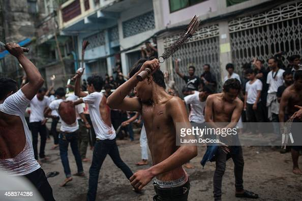 Shi'ite Muslim men participate in Ashura a commemoration involving selfflagellation to mourn the martyrdom of Husayn ibn Ali the grandson of Muhammad...