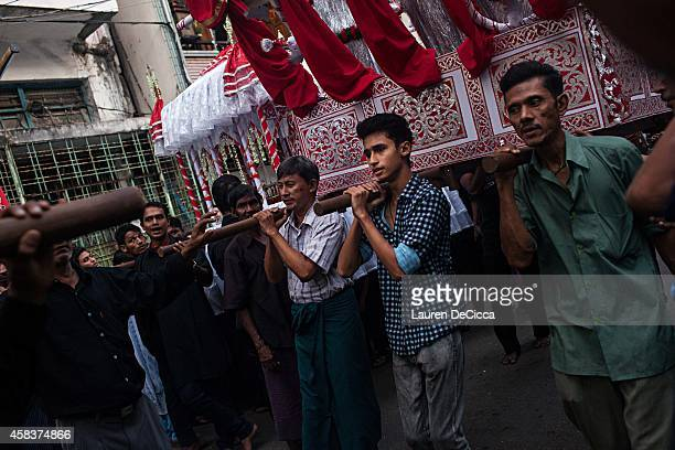 Shi'ite Muslim men participate in the Ashura procession a commemoration involving selfflagellation to mourn the martyrdom of Husayn ibn Ali the...