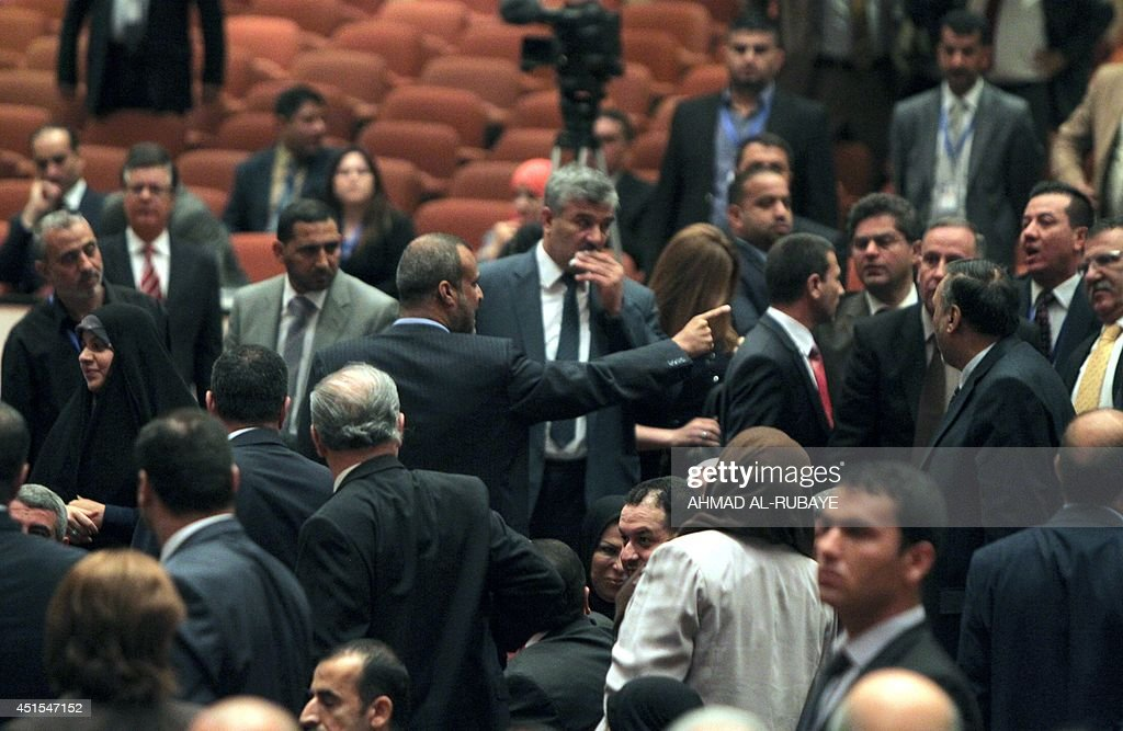 Shiite Muslim MP Kadhim alSayadi a lawmaker in Prime Minister Nuri alMaliki's bloc points a finger as he argues with Kurdish deputies during the...