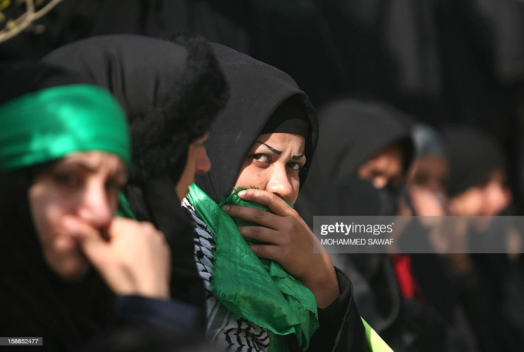 A Shiite Muslim pilgrim looks on during the Arbaeen religious festival which marks the 40th day after Ashura commemorating the seventh century killing of Prophet Mohammed's grandson, Imam Hussein, in the shrine city of Karbala, southwest of Iraq's capital Baghdad, on January 1, 2013.