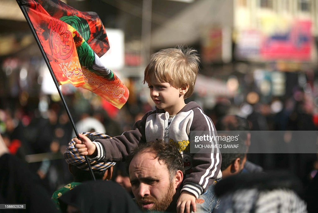 Shiite Muslim pilgrims join the Arbaeen religious festival which marks the 40th day after Ashura commemorating the seventh century killing of Prophet Mohammed's grandson, Imam Hussein, in the shrine city of Karbala, southwest of Iraq's capital Baghdad, on January 1, 2013.