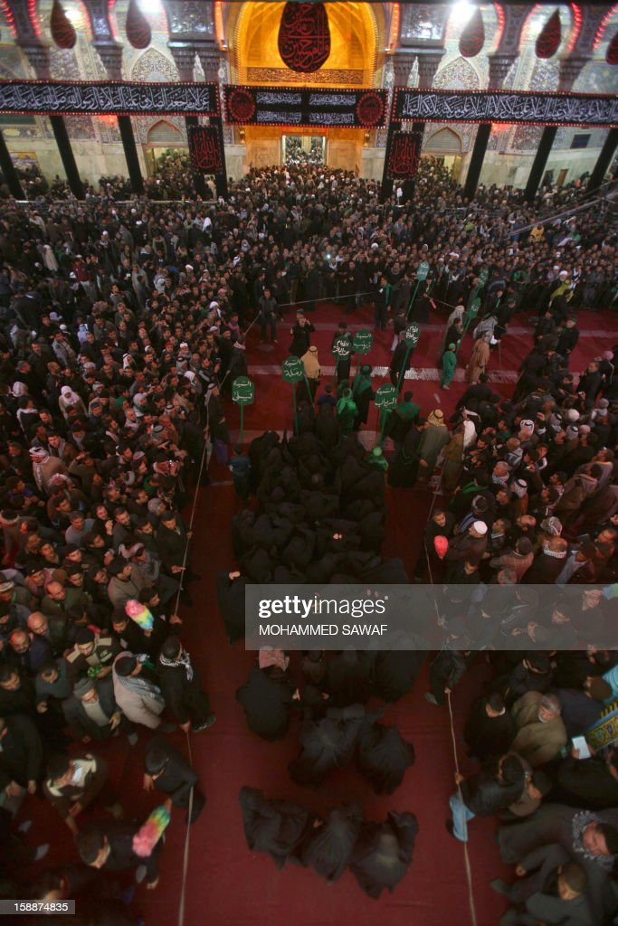 Shiite Muslim pilgrims take part in the Arbaeen religious rituals which marks the 40th day after Ashura commemorating the seventh century killing of Prophet Mohammed's grandson, Imam Hussein, in the shrine city of Karbala, southwest of Iraq's capital Baghdad, on January 2, 2013. AFP PHOTO/MOHAMMED SAWAF
