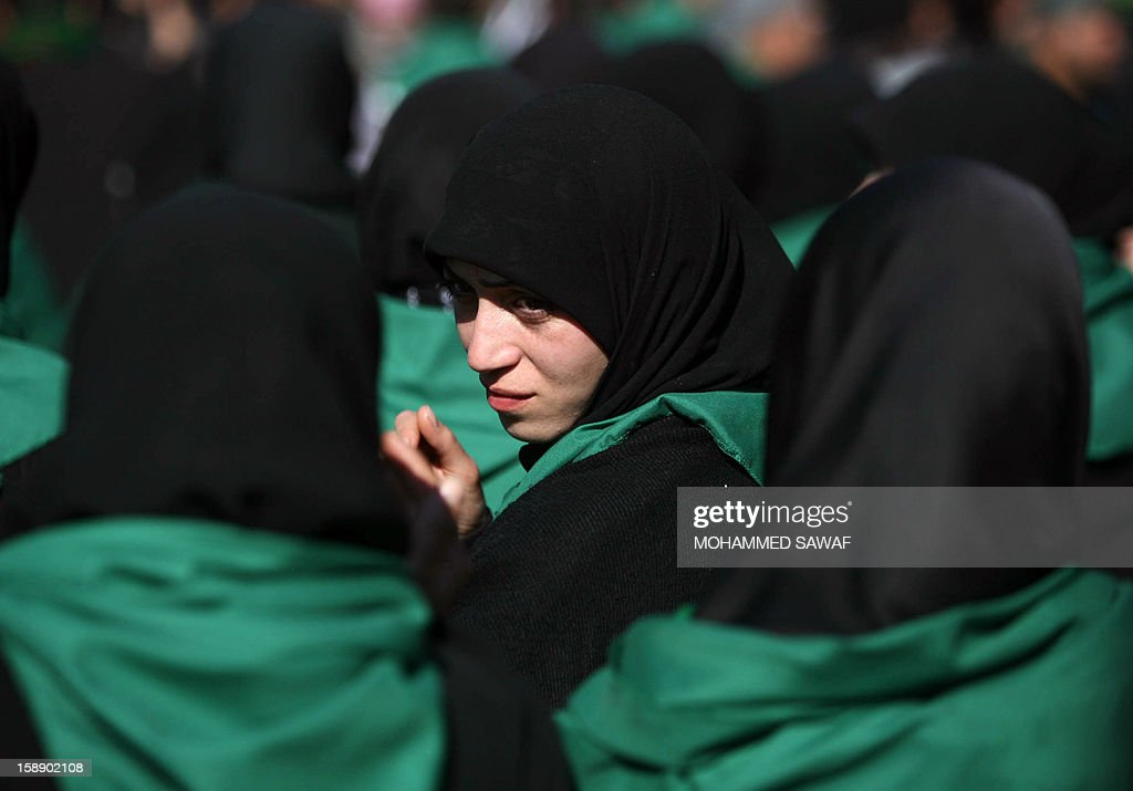 A Shiite Muslim woman attends the Arbaeen religious festival in the shrine city of Karbala, southwest of Iraq's capital Baghdad, on January 3, 2013 to mark the 40th day after Ashura, commemorating the seventh century killing of Prophet Mohammed's grandson, Imam Hussein.