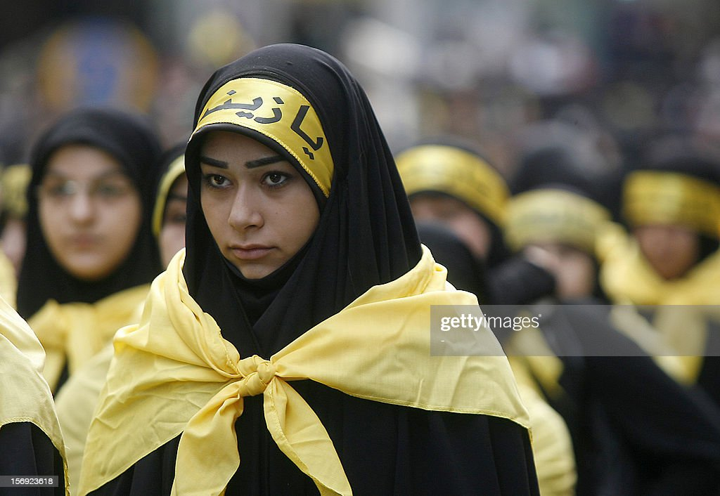 A Shiite Muslim woman looks on during a rally in the southern suburbs of the Lebanese capital Beirut, on November 25, 2012, to mark Ashura, commemorating the death of Imam Hussein, grandson of the Prophet Mohammed, who was killed in 680 AD by the armies of the caliph Yazid in present day Iraq.