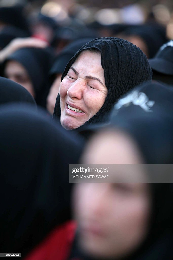 A Shiite Muslim woman mourns during the Arbaeen religious festival in the shrine city of Karbala, southwest of Iraq's capital Baghdad, on January 3, 2013 to mark the 40th day after Ashura, commemorating the seventh century killing of Prophet Mohammed's grandson, Imam Hussein. AFP PHOTO / MOHAMMED SAWAF