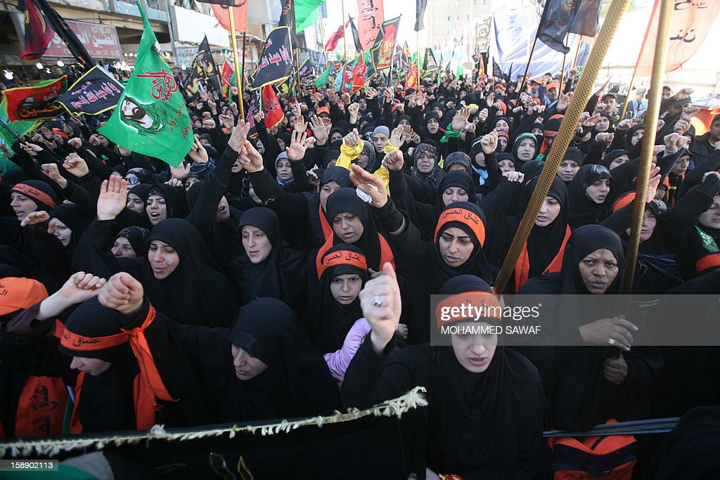 Shiite Muslim women attend the Arbaeen religious festival in the shrine city of Karbala, southwest of Iraq's capital Baghdad, on January 3, 2013 to mark the 40th day after Ashura, commemorating the seventh century killing of Prophet Mohammed's grandson, Imam Hussein.