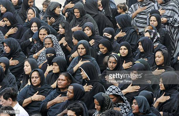 Shiite Muslim women beat their chests during a Muharram procession taken out to mark the 7th day of Islamic month of Muharram on November 12 2013 in...