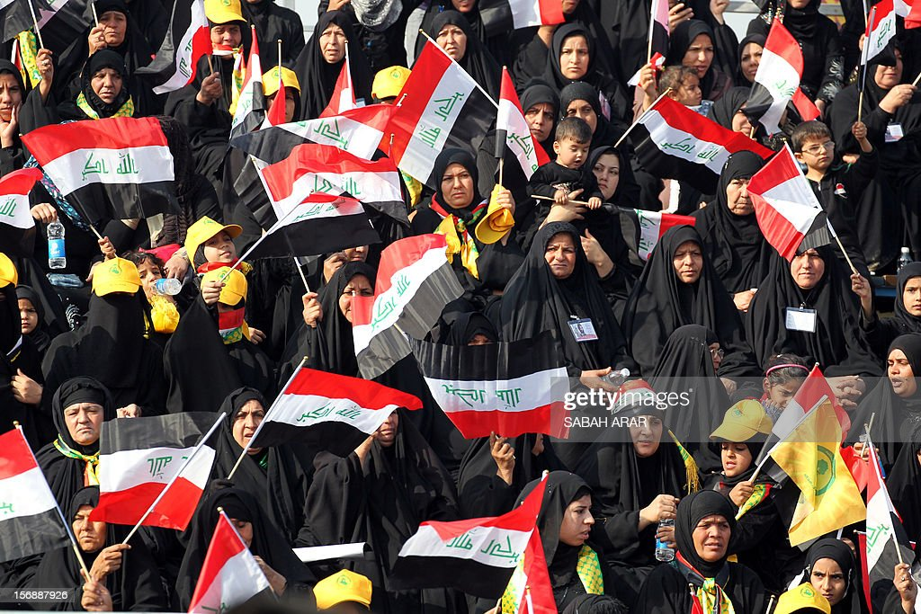 Shiite Muslim women wave the Iraqi flag as they gather to hear an address by Iraqi Shiite Muslim leader Ammar al-Hakim of the Supreme Iraqi Islamic Council, as Shiites commemorate the death of Imam Hussein during Ashura in the capital Baghdad, on November 24, 2012. Shiites around the world are marking the slaying of the Prophet Mohammed's grandson, the Imam Hussein, in the seventh century. Millions of pilgrims are flooding to the holy central Iraqi city of Karbala for the peak of the Ashura rituals, which occurs on November 25 this year.