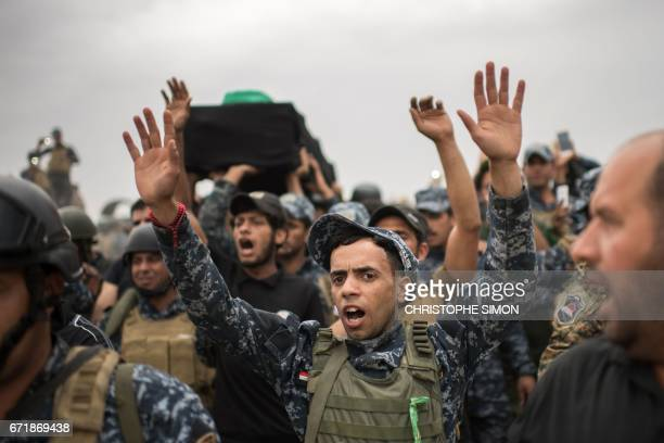 Shiite Muslim worshippers and members of the Iraqi Federal Police commemorate the anniversary of the death of the 8th century Imam Musa alKadhimin in...