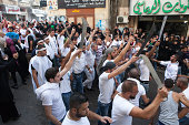 Shi'ite muslims carrying swords and knives during an Ashura Day commemoration in Nabatieh Lebanon Ashura Day is an annual festival amongst the...
