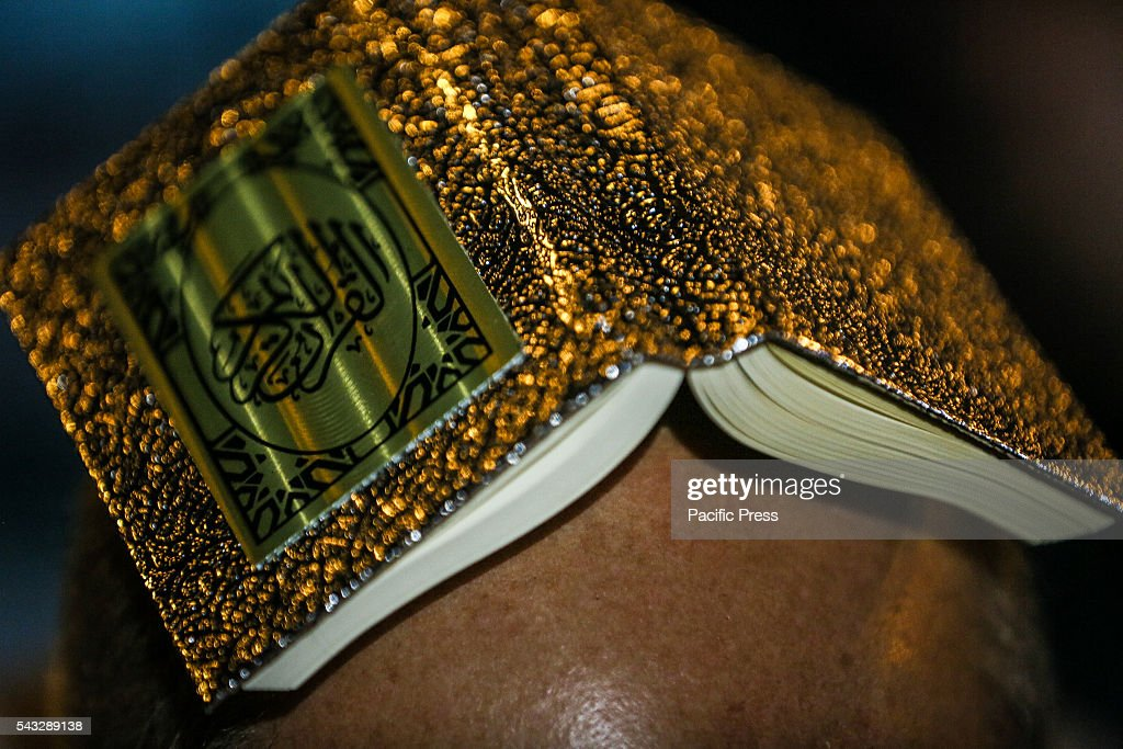 Shiite Muslims hold the Koran on their heads as they pray on Lailat al-Qadr (Night of Power) which marks the night in which the holy Koran was first revealed to the Prophet Mohammed, outside the Fatimeyi-Zahra Mosque in Baku.