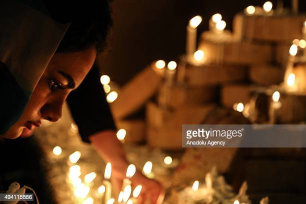 Shiite Muslims light candles to commemorate the martyrdom of Prophet Mohammad's grandson Imam Hussein and his accompanies who were killed in the...