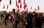 Shiite Muslims march on the highway during a symbolic procession commemorating the 40th anniversary of the Ashura religious ceremony on November 27...