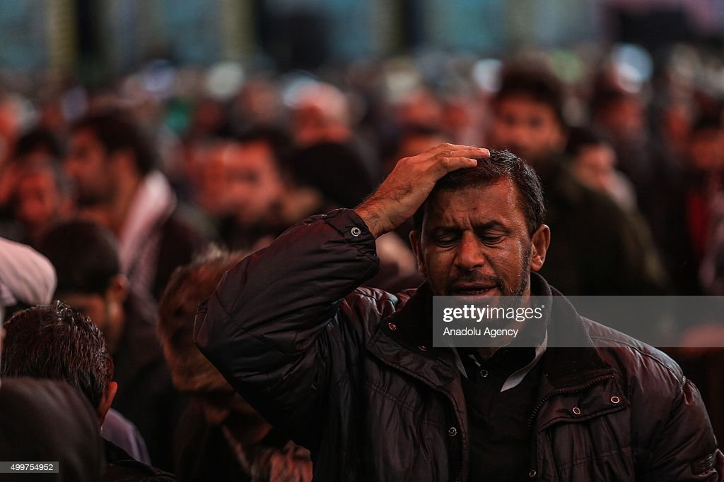 Shi'ite Muslims pray and worship at the Imam Abbas Shrine during the Arbaeen ceremony in the Iraqi city of Karbala on December 03 2015 Hundreds of...
