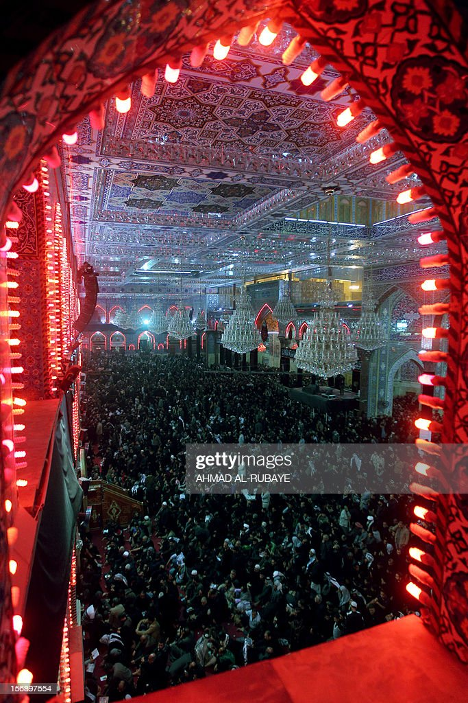 Shiite Muslims pray at the shrine of Imam Hussein on November 24, 2012 in Karbala during the celebration of Ashura. Shiite Muslims marching during Ashura rituals in the Iraqi shrine city of Karbala today mixed mourning the death of Imam Hussein over 1,300 years ago with chants condemning modern politicians.