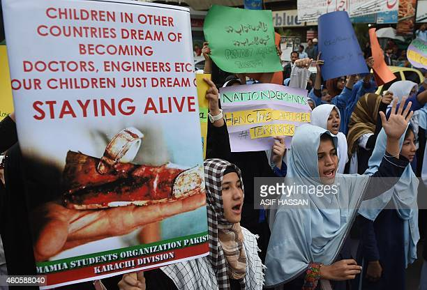 Shiite students of Imamia Students Organization hold placards as they protest against an attack by Taliban militants at an armyrun school in Peshawar...