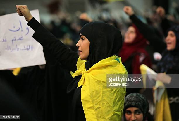 A Shiite supporter shouts slogans during a meeting with Hassan Nasrallah the head of Lebanon's militant Shiite Muslim movement Hezbollah addressing...