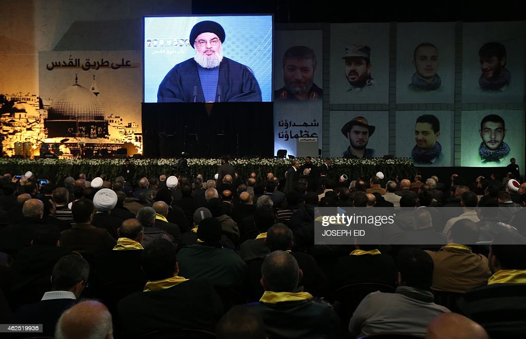 Shiite supporters watch <a gi-track='captionPersonalityLinkClicked' href=/galleries/search?phrase=Hassan+Nasrallah&family=editorial&specificpeople=615774 ng-click='$event.stopPropagation()'>Hassan Nasrallah</a>, the head of Lebanon's militant Shiite Muslim movement Hezbollah, addressing them through a giant screen on January 30, 2014 in Beirut's southern suburb of Mujammaa Sayyed al-Shuhada. Hezbollah chief said he does not want war with Israel, after the Israeli military shelled border areas following a Hezbollah attack that left two Israeli soldiers dead.