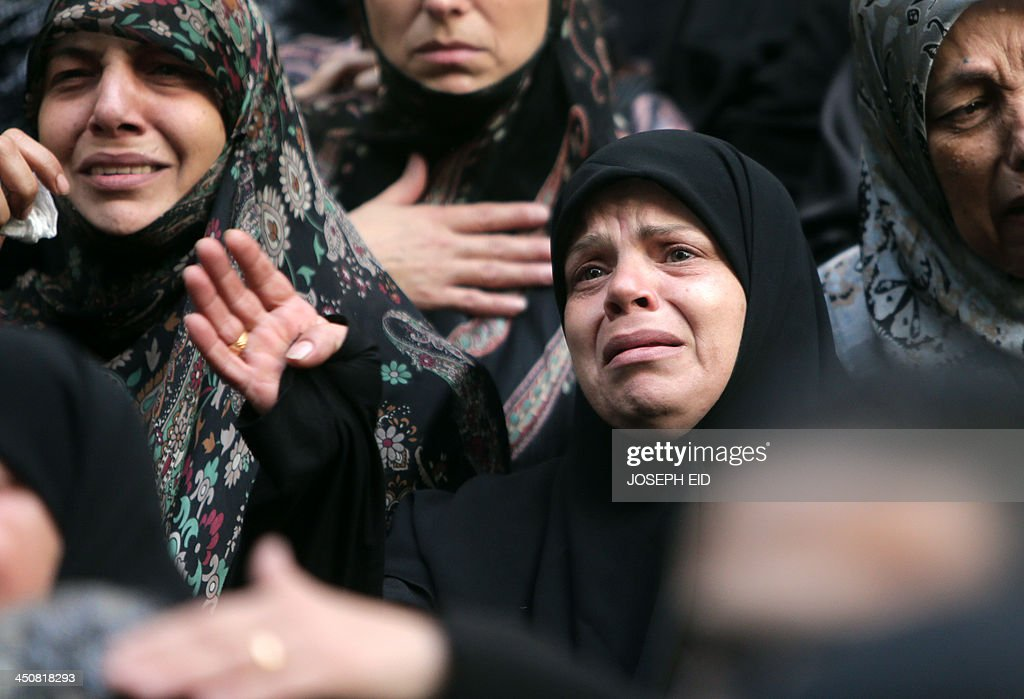 Shiite women mourn during the funeral of Hezbollah militants in Shiah, a southern suburb of the Lebanese capital, who were killed in the suicide attack outside the Iranian Embassy in Beirut the previous day, on November 20, 2013. Thousands of people turned out for a funeral for the four Iranian embassy security guards, all of whom were members of Lebanon's powerful Shiite movement Hezbollah, which is also backed by Iran and is fighting alongside Assad's troops against Sunni-led rebels. AFP PHOTO/JOSEPH EID