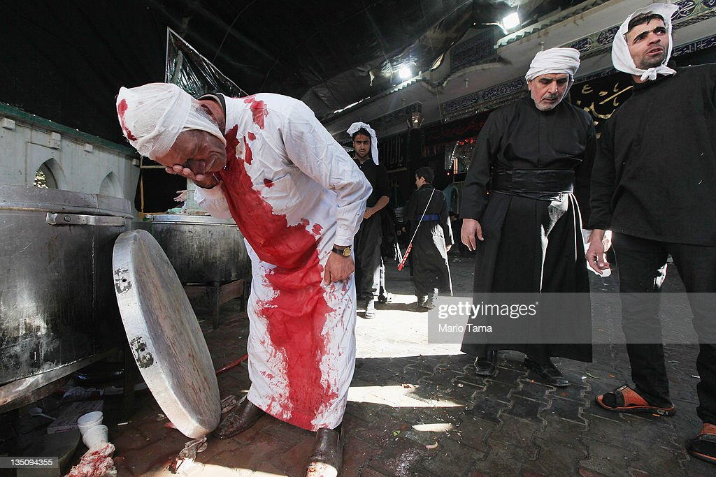 A Shi'ite worshiper washes himself after cutting his scalp in a ritual display of mourning during an Ashura commemoration ceremony outside Kadhimiya shrine on December 6, 2011 in Baghdad, Iraq. Ashura marks the death of Prophet Muhammad's grandson the revered Imam Hussein in Karbala, Iraq in 680 AD. Shi'ite festivals were prohibited during the time of Sunni dictator Saddam Hussein's rule. Iraq is transitioning nearly nine years after the 2003 U.S. invasion and subsequent occupation. American forces are now in the midst of the final stage of withdrawal from the war-torn country. According to the Iraq Body Count at least 4,485 U.S. military personnel have died in service in Iraq and more than 100,000 Iraqi civilians have died from war-related violence.
