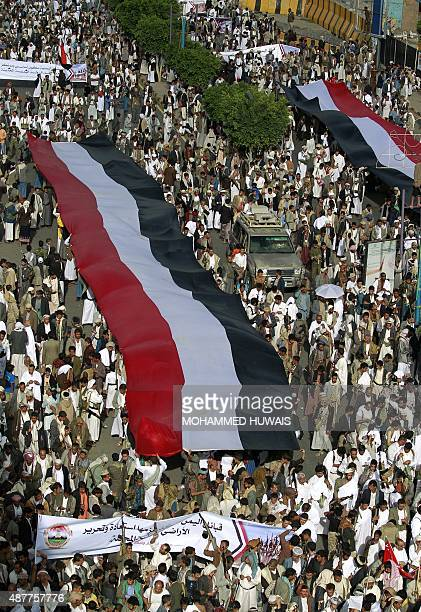 ShiiteHuthi supporters hold a large Yemeni flag as they protest in the capital Sanaa against ongoing military operations carried out by the Saudiled...