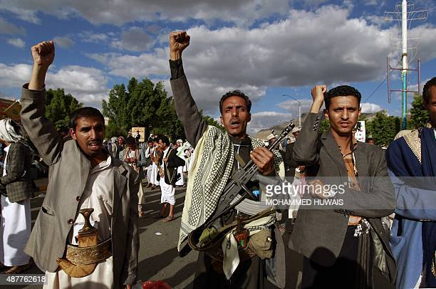 ShiiteHuthi supporters shout slogans during a protest in the Yemeni capital Sanaa against ongoing military operations carried out by the Saudiled...