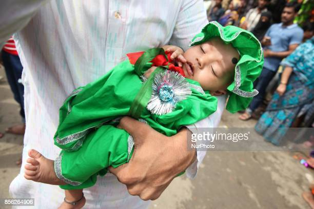 Shiites man with his baby to participate in a religious rally with amid security during the celebration of the day Ashura on 10th of Muharram the...