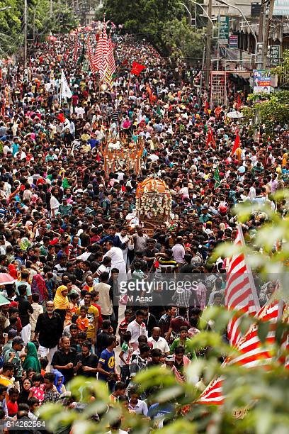 OLD DHAKA DHAKA BANGLADESH Shiites Muslims people with flag join in a religious rally during the celebration of the day Ashura on 10th of Muharram...