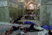 Shiites volunteers sleep inside the AlAskari shrine which is under repair and embraces the tombs of the 10th and 11th Imams Ali AlHadi his son Hassan...