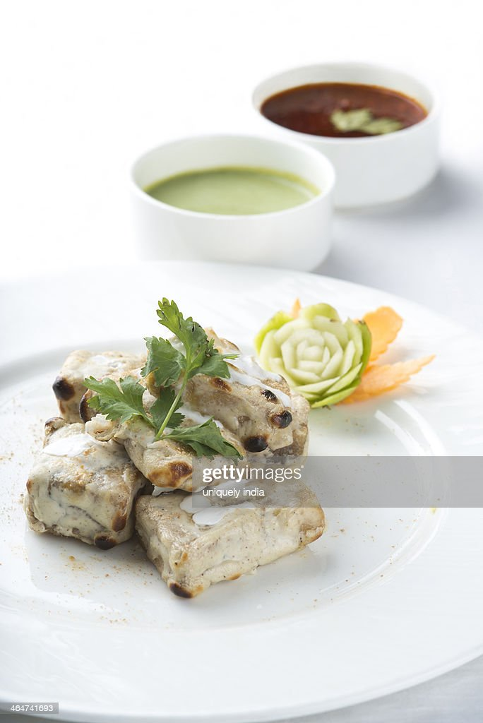 Shikampuri Kebabs served in a plate : Stock Photo