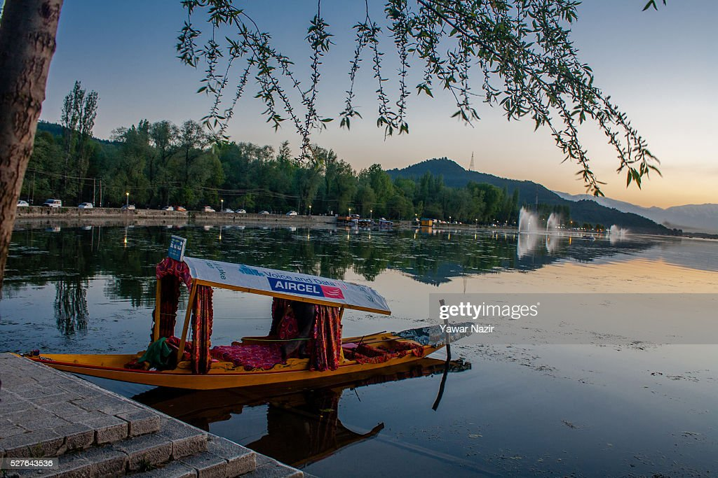 A shikara boat is moored to the bank of Dal lake on May 03, 2016 Srinagar, the summer capital of Indian administered Kashmir, India. Kashmir the Muslim majority state , is known as the 'Paradise on Earth' and has for centuries captured the imagination of many writers, poets and film makers and is integral to the tourist trade. Kashmir has been a contested land between nuclear neighbors India and Pakistan since 1947, the year both the countries attained freedom from the British rule.