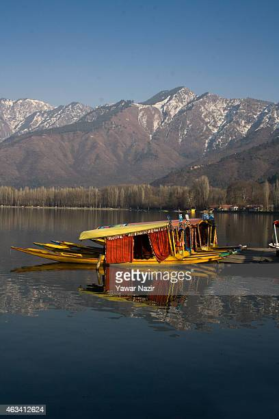 Shikara boats are moored to the bank of Dal Lake on February 14 2015 in Srinagar the summer capital of Indian administered Kashmir India Dal Lake one...