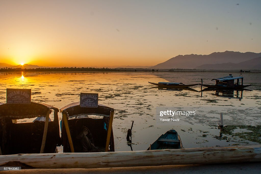 Shikara boats are moored to the bank of Dal lake on May 03, 2016 Srinagar, the summer capital of Indian administered Kashmir, India. Kashmir the Muslim majority state , is known as the 'Paradise on Earth' and has for centuries captured the imagination of many writers, poets and film makers and is integral to the tourist trade. Kashmir has been a contested land between nuclear neighbors India and Pakistan since 1947, the year both the countries attained freedom from the British rule.