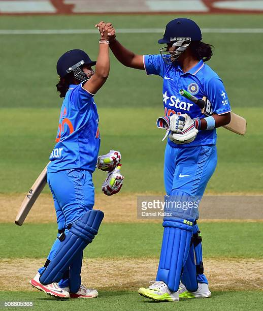 Shikha Pandey of India and Anuja Patil of India react after scoring the winning runs during the women's Twenty20 International match between...