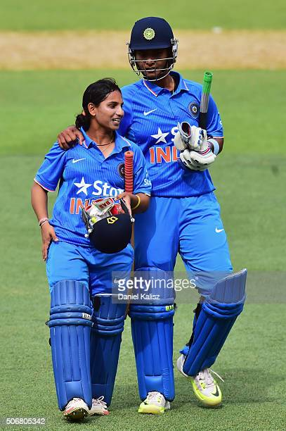 Shikha Pandey of India and Anuja Patil of India reacts as they walk off the field after the women's Twenty20 International match between Australia...