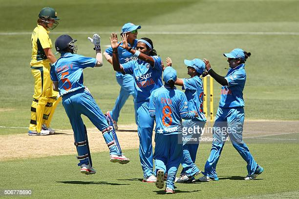 Shikha Pandey of India is congratulated by teammates celebrates after taking the wicket of Meg Lanning of Australia during the women's Twenty20...