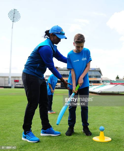 Shikha Pandey of India takes part in a batting activity alongside school children during the Cricket for Good India event at The County Ground on...