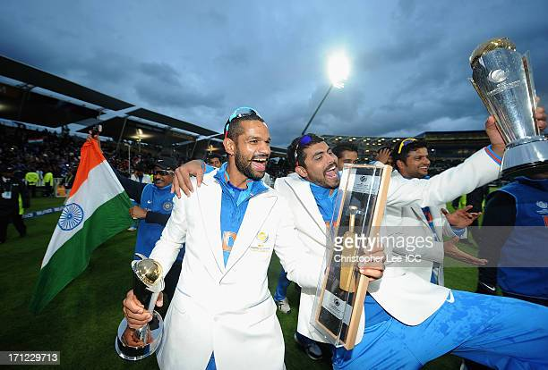 Shikhar Dhawan and Ravindra Jadeja of India celebrate their victory with their player awards and the Champions Trophy after the ICC Champions Trophy...